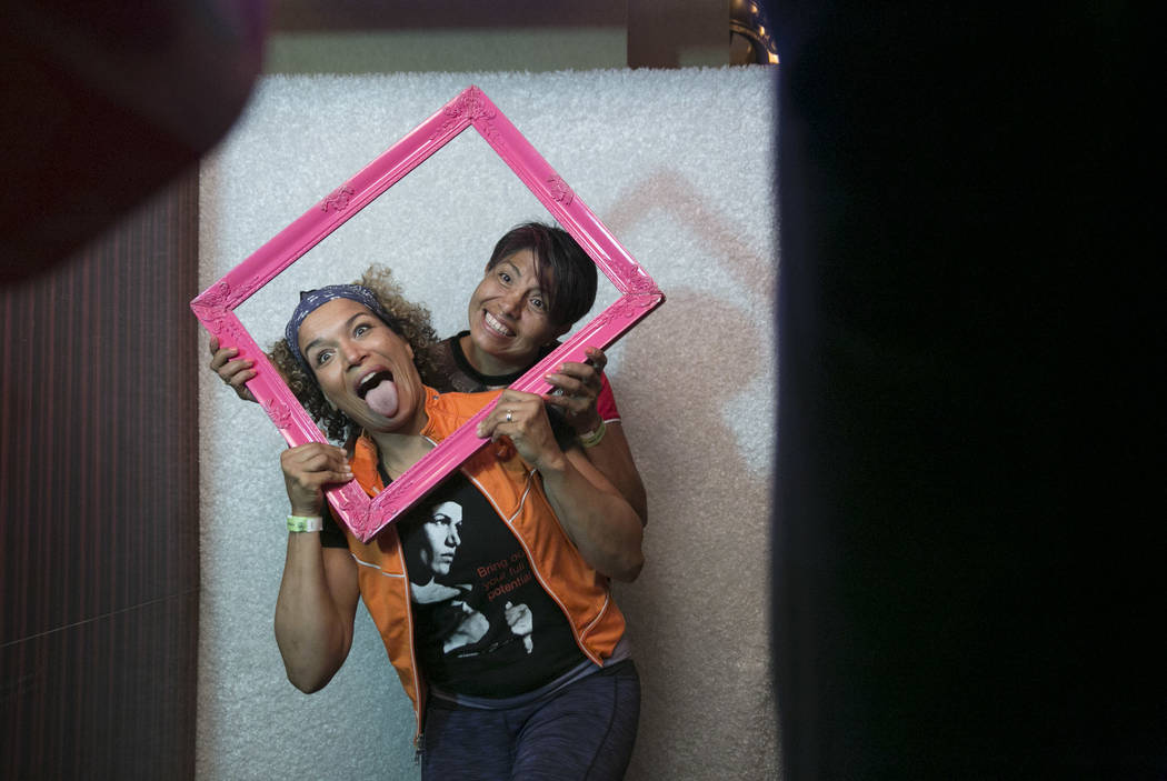 Lucia Rijker (left), Boxing and Kickboxing champion, poses for a silly photo with Laura Serrano, first Mexican female fighter to be in the International Women's Boxing Hall of Fame, during a Fan m ...