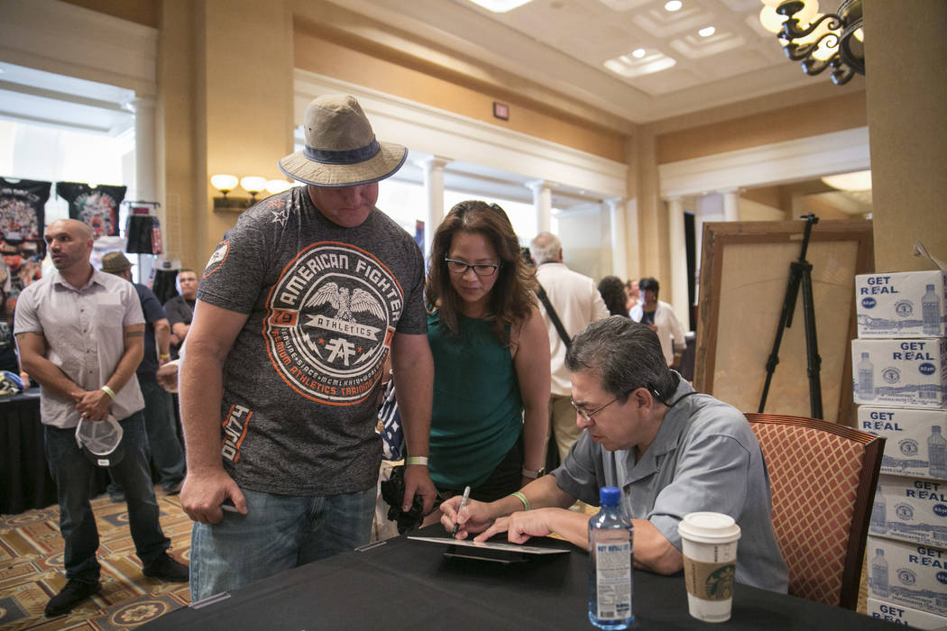 Richie Sandoval, right, Olympian and Bantamweight Champion, meets with fans during a Fan meet-and-greet before the 2017 Nevada Boxing Hall of Fame ceremony in The Palace Ballroom at Caesars Palace ...