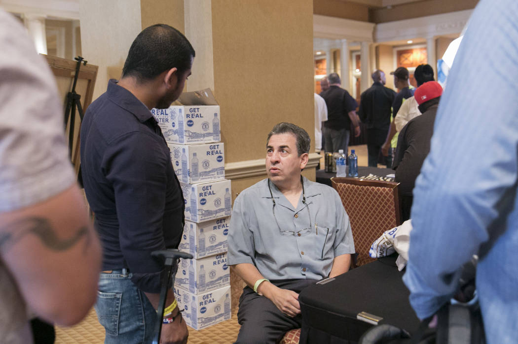 Richie Sandoval, center, Olympian and Bantamweight Champion, meets with fans during a Fan meet-and-greet before the 2017 Nevada Boxing Hall of Fame ceremony in The Palace Ballroom at Caesars Palac ...