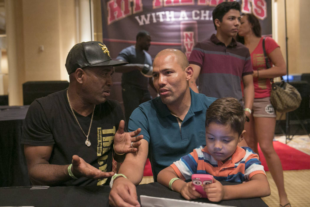 Joel Casamayor (left), Olympic champion and  two-weight world champion, talks to Jose Luis Castillo (center), two-time lightweight world champion, during a Fan meet-and-greet before the 2017 Nevad ...