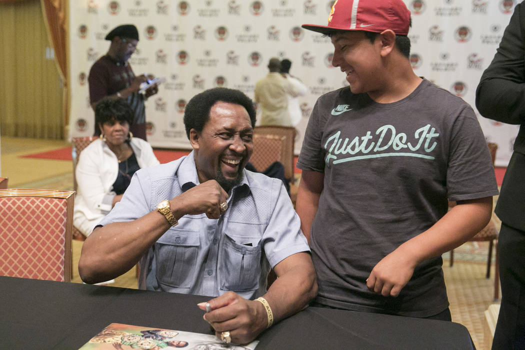 "Thomas ""Hitman"" Hearns, four-time world champion and 2017 inductee, laughs with Adrain Reyna, 12, during a Fan meet-and-greet before the 2017 Nevada Boxing Hall of Fame ceremony  ..."