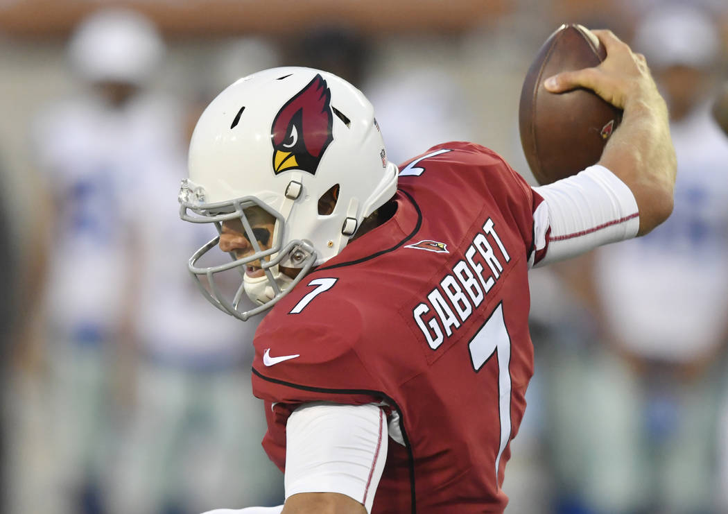 Arizona Cardinals quarterback Blaine Gabbert loses his balance while being sacked during the first half of the Pro Football Hall of Fame NFL preseason game against the Dallas Cowboys in Canton, Oh ...