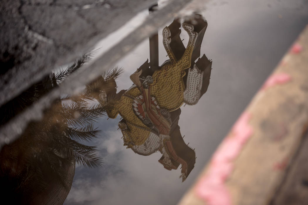 A reflection of a neon sign in a street puddle along Las Vegas Blvd. on Friday, August 4, 2017, in Las Vegas. Morgan Lieberman Las Vegas Review-Journal