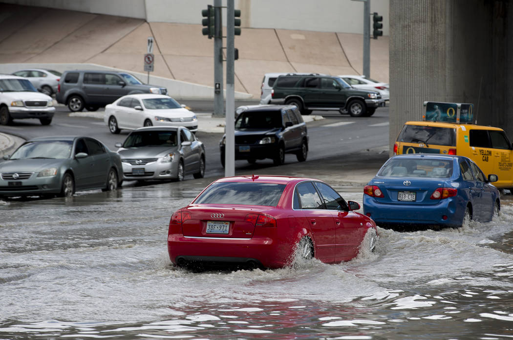 Drivers attempt to navigate a flooded area near the intersection of Dean Martin Drive and West Twain Ave on Friday, Aug. 4, 2017, in Las Vegas. Bridget Bennett Las Vegas Review-Journal @bridgetkbe ...
