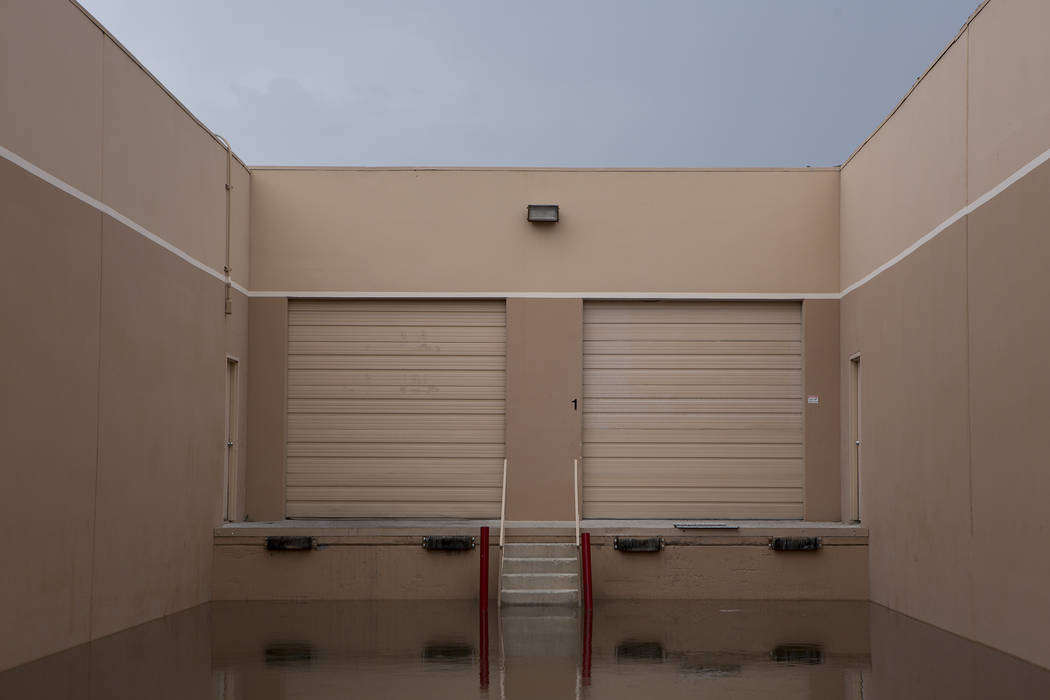 Water fills an loading area of a business on South Highland Drive, just north of Rio hotel-casino after rainfall on Friday, Aug. 4, 2017, in Las Vegas. Bridget Bennett Las Vegas Review-Journal @br ...