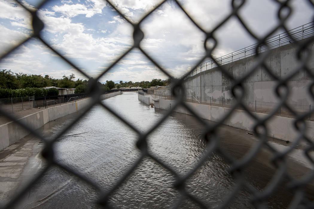 Water flows down a wash near the intersection of East Sahara Avenue and Boulder Highway after rainfall on Friday, Aug. 4, 2017, in Las Vegas. Bridget Bennett Las Vegas Review-Journal @bridgetkbennett
