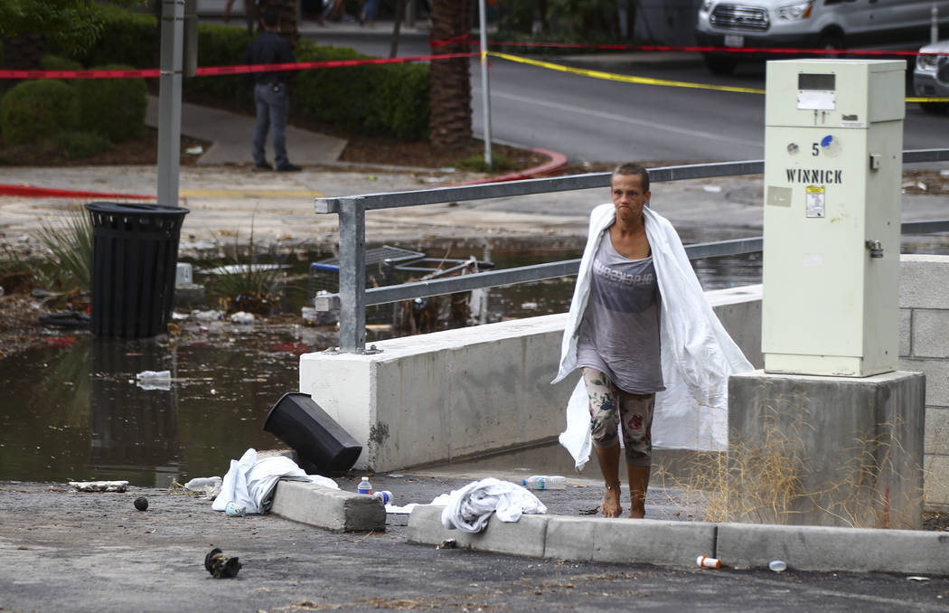 A woman who appears to have been rescued from the wash behind The Linq Hotel in Las Vegas on Friday, Aug. 4, 2017. Six people were rescued from the wash. Chase Stevens Las Vegas Review-Journal @cs ...