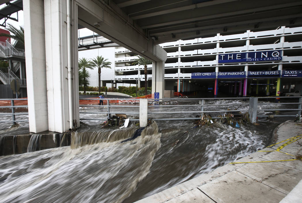 Water flows through the wash behind The Linq Hotel in Las Vegas on Friday, Aug. 4, 2017. Six people were rescued from the wash. Chase Stevens Las Vegas Review-Journal @csstevensphoto