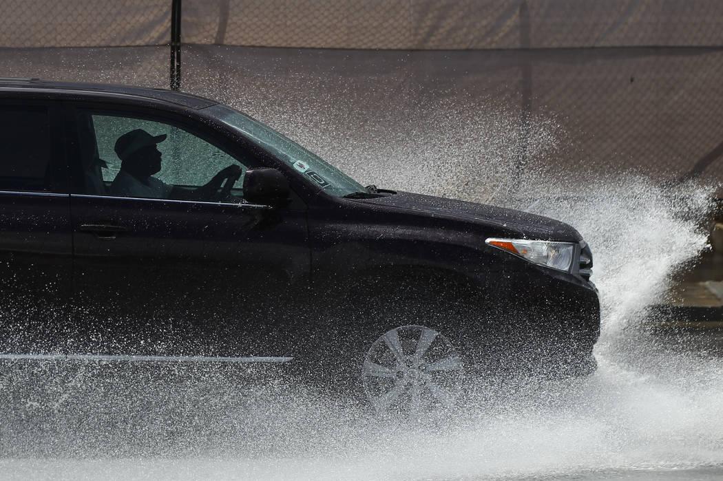 Traffic passes through floodwaters along Swenson Street near Tropicana Avenue in Las Vegas on Friday, Aug. 4, 2017. Chase Stevens Las Vegas Review-Journal @csstevensphoto