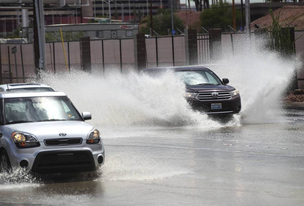 Traffic passes through floodwaters along Swenson Street near Tropicana Avenue in Las Vegas on Friday, Aug. 4, 2017. Chase Stevens Las Vegas Review-Journal @csstevensphoto