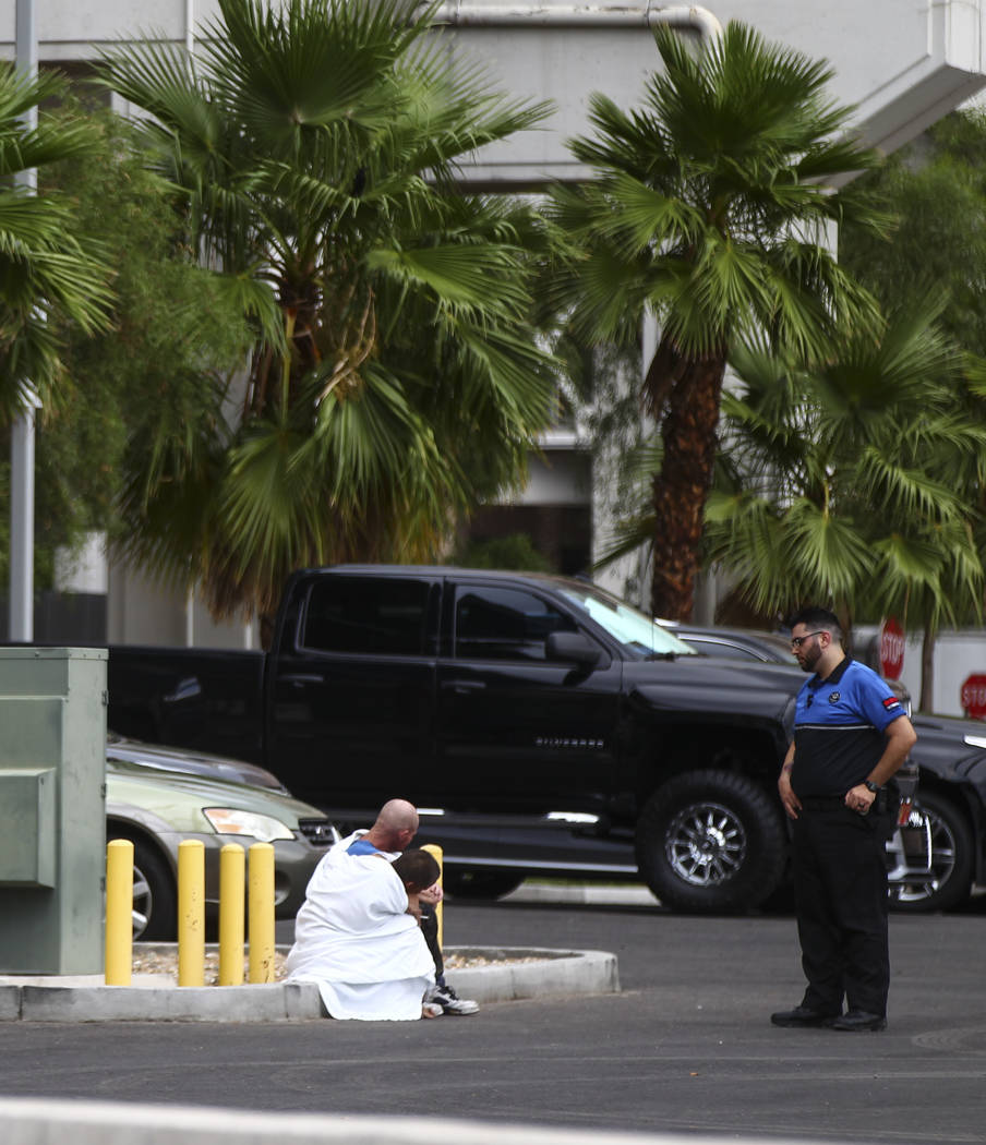 Two people who appear to have been rescued from the wash behind The Linq Hotel in Las Vegas on Friday, Aug. 4, 2017. Six people were rescued from the wash. Chase Stevens Las Vegas Review-Journal @ ...