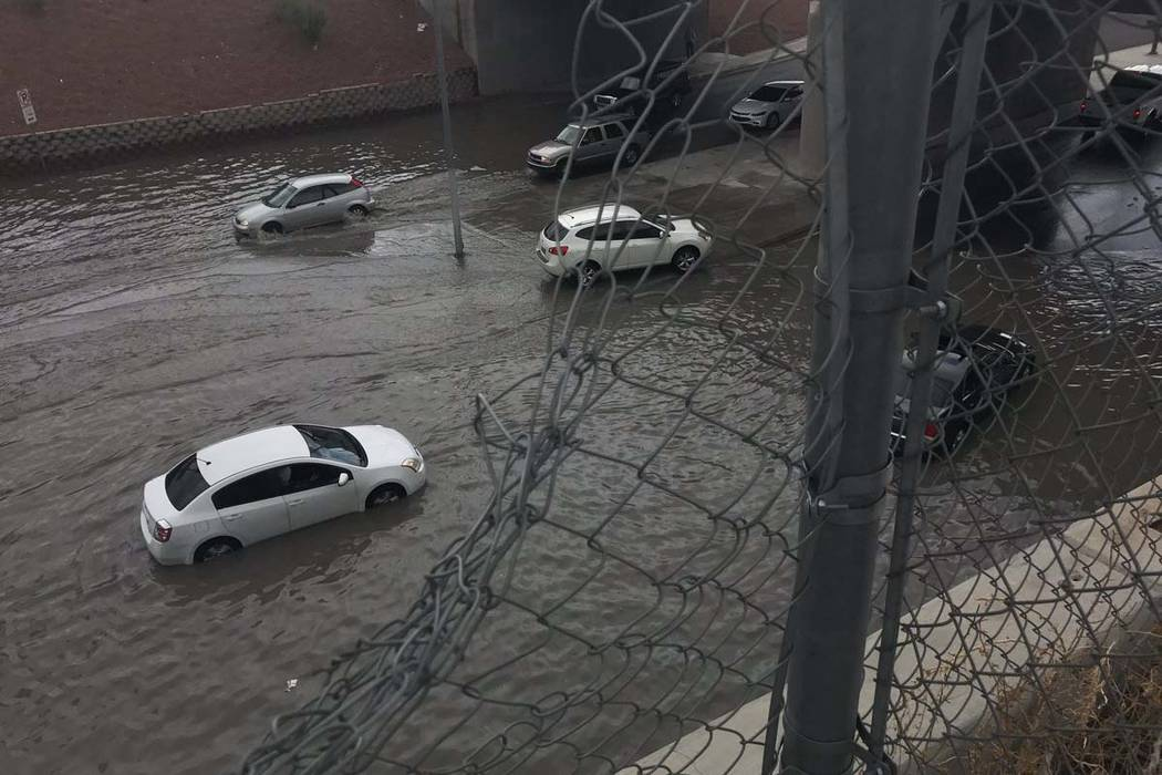Cars stuck in flooding at Dean Martin Drive and Twain Avenue, Friday, Aug. 4, 2017. (Bridget Bennett/Las Vegas Review-Journal)