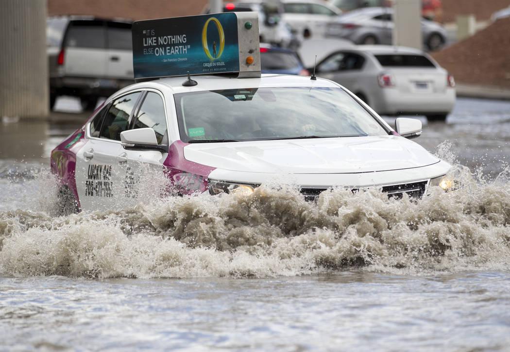 A taxi drives through flood waters on West Twain Avenue near Dean Martin Drive following rain fall on Friday, August 4, 2017, in Las Vegas. Richard Brian Las Vegas Review-Journal @vegasphotograph