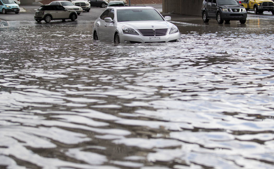A stalled vehicle sits in flood waters on West Twain Avenue near Dean Martin Drive following rain fall on Friday, August 4, 2017, in Las Vegas. Richard Brian Las Vegas Review-Journal @vegasphotograph