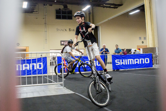 People test different brands of eBikes at a track at the annual Interbike International Bicycle Exposition at the Mandalay Bay Convention Center, Wednesday Sept. 21, 2016, in Las Vegas. Elizabeth  ...