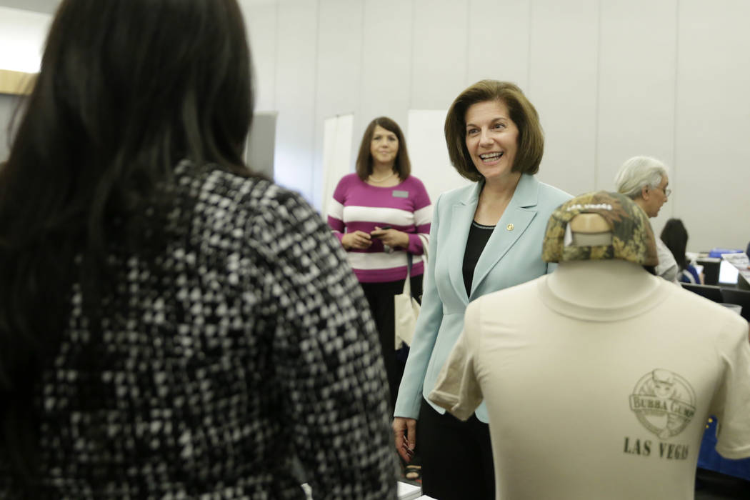 U.S. Senator Catherine Cortez Masto talks to recruiters during a Veteran and Family Career Fair at the University of Nevada, Las Vegas in Las Vegas, Saturday, July 22, 2017.  The event was sponsor ...