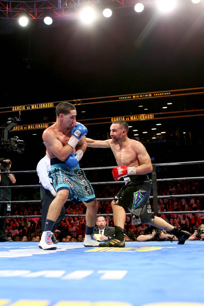 Danny Garcia, left, in action against Paul Malignaggi during their welterweight fight at the Barclays Center in Brooklyn, on Saturday, August 1, 2015. Garcia won via TKO in Round 9.  (AP Photo/Gre ...