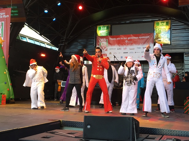 Elvis tribute artist Jesse Garon performs with the OP Elvi on the Third Street Stage at Fremont Street Experience during the 12th annual Great Santa Run, benefitting Opportunity Village, Sat, Dec. ...