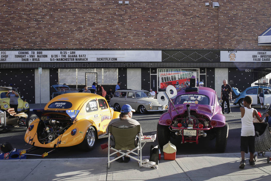 Cliff Cruz, 57, of Las Vegas, center, sits in between his 1955 Volkswagen Beetle Drag Race car, left, and his 1959 Volkswagen Beetle Street car, right, at the Abbey Road Crossing Beatles Celebrati ...