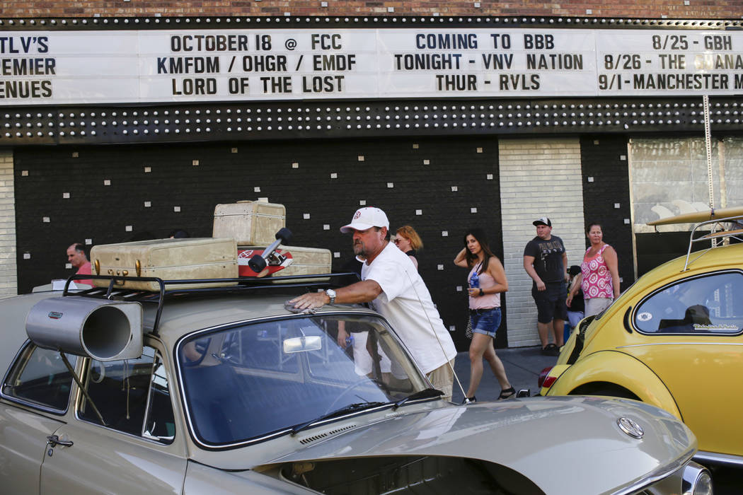 Bruce Costa, center, of Las Vegas, buffs his 1965 Volkswagen Notchback at the Abbey Road Crossing Beatles Celebration in front of the El Cortez in Las Vegas, Saturday, Aug. 19, 2017.  Gabriella An ...