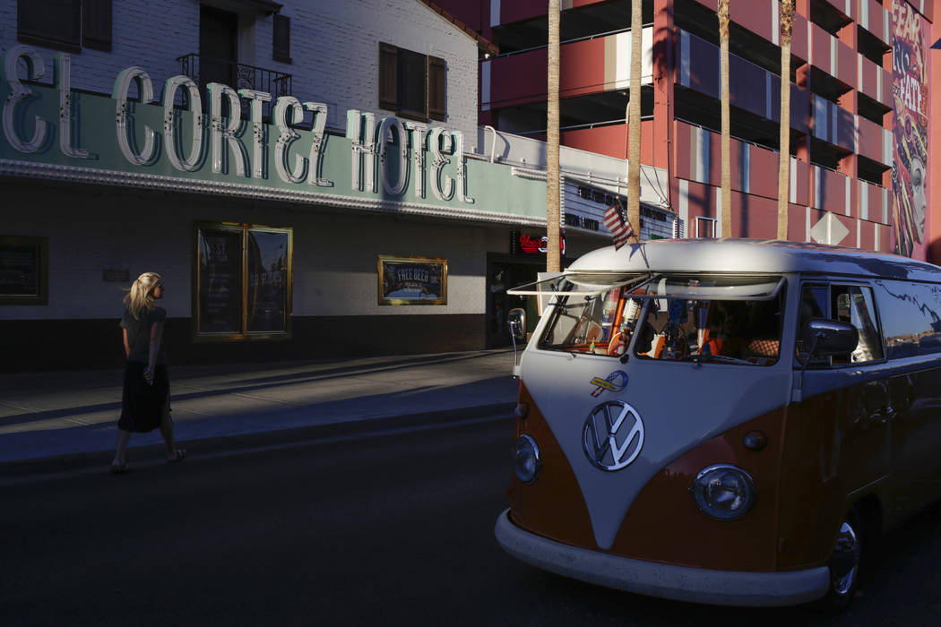 A woman passes by a 1959 Volkswagen Bus during the Abbey Road Crossing Beatles Celebration in front of the El Cortez in Las Vegas, Saturday,Aug. 19, 2017.  Gabriella Angotti-Jones Las Vegas Review ...
