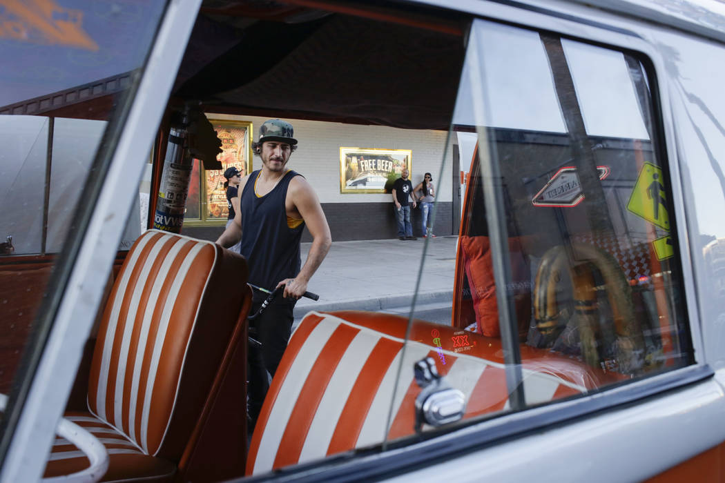 Jeremy Wynn of Downtown Las Vegas checks out a 1959 Volkswagen Bus during the Abbey Road Crossing Beatles Celebration in front of El Cortez Hotel and Casino on Fremont Street in Las Vegas, on  Sat ...