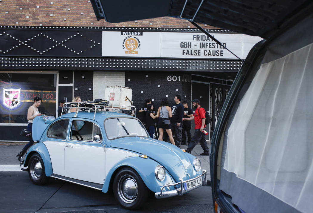 Pedestrians pass by a Volkswagen Beetle during the Abbey Road Crossing Beatles Celebration in front of the El Cortez in Las Vegas, Saturday, Aug. 19, 2017.  Gabriella Angotti-Jones Las Vegas Revie ...
