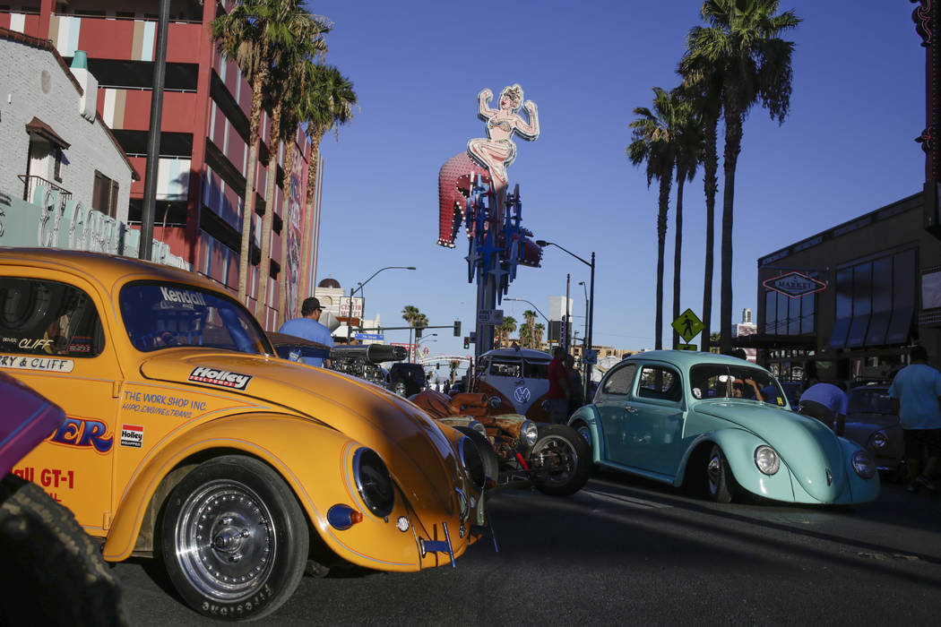 Cliff Cruz of Las Vegas's 1955 Volkswagen Beetle Drag Race car, left, and other vintage Beetles at the Abbey Road Crossing Beatles Celebration in front of the El Cortez  in Las Vegas, Saturday, Au ...