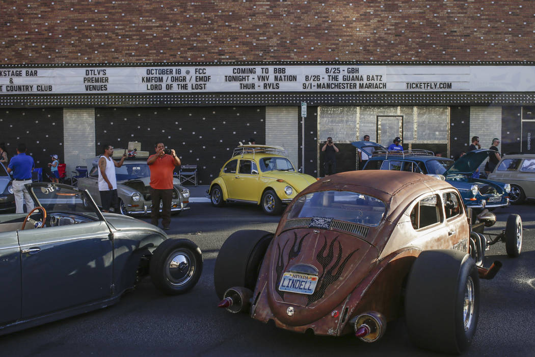 Pedestrians photograph a Volkswagen Beetle Hot Rod during the Abbey Road Crossing Beatles Celebration in front of the El Cortez in Las Vegas, Saturday, Aug. 19, 2017.  Gabriella Angotti-Jones Las  ...