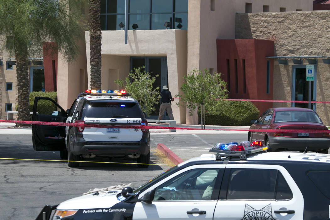 Police roll out the crime scene tape following an officer involved shooting at the Life Springs Christian Church on East Warm Springs Road and Burnham Avenue, Saturday, August 5, 2017, in Las Vega ...
