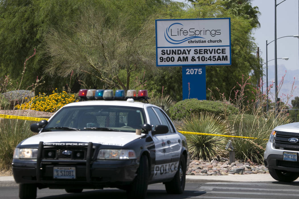 Police cordon off the scene of an officer involved shooting at the Life Springs Christian Church on East Warm Springs Road and Burnham Avenue, Saturday, August 5, 2017, in Las Vegas. Richard Brian ...