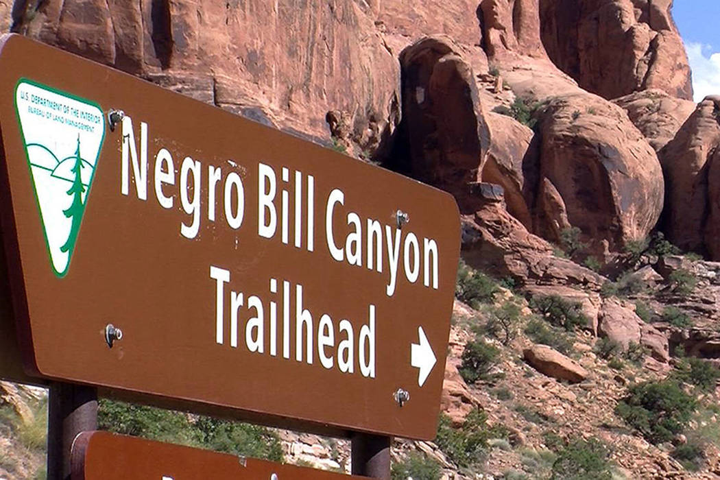 A sign is seen at the entrance of the Negro Bill Canyon Trailhead in Moab, Utah. (John Hollenhorst/The Deseret News via AP, File)