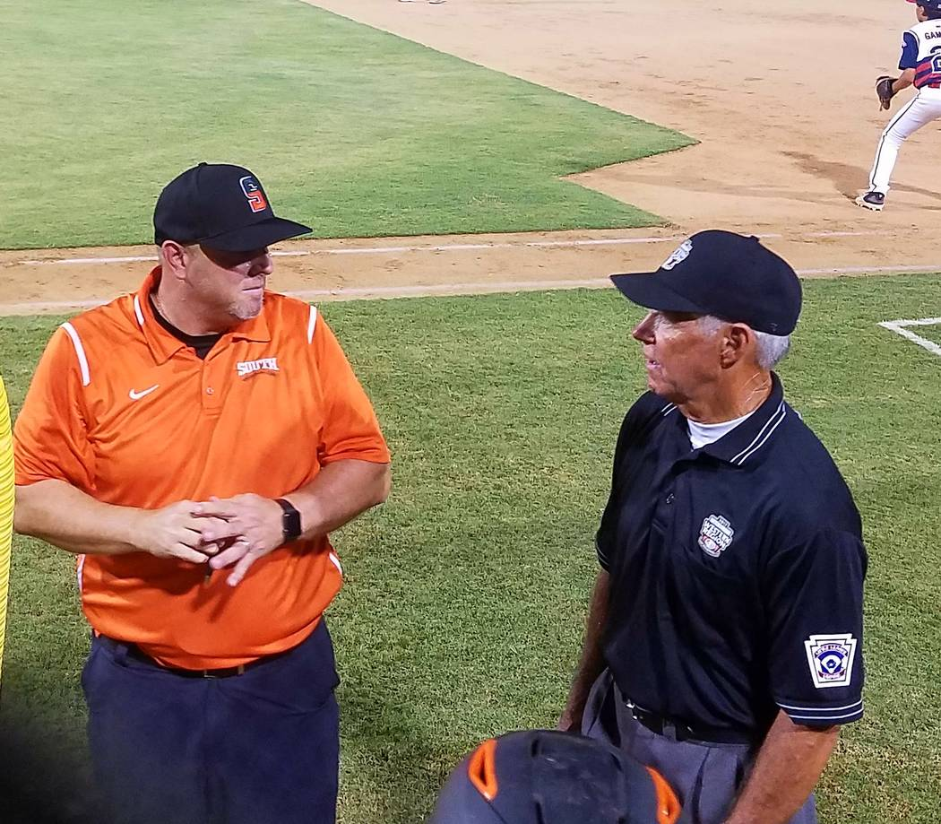 Summerlin South manager Adam Grant, left, talks to an umpire in between innings during the game against Southern California in San Bernardino, Calf., Sunday, Aug. 6, 2017. Lou Ponsi Las Vegas Revi ...