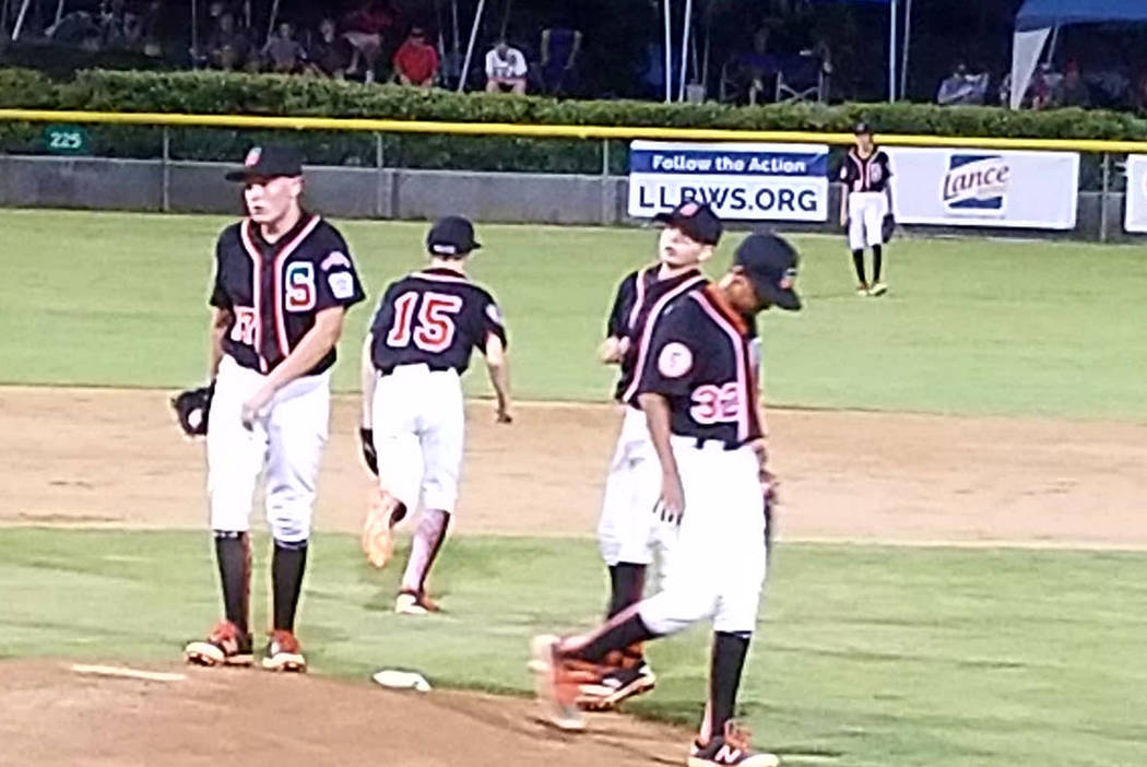 Summerlin players meet on the mound  during the game against Southern California in San Bernardino, Calf., Sunday, Aug. 6, 2017. Lou Ponsi Las Vegas Review-Journal