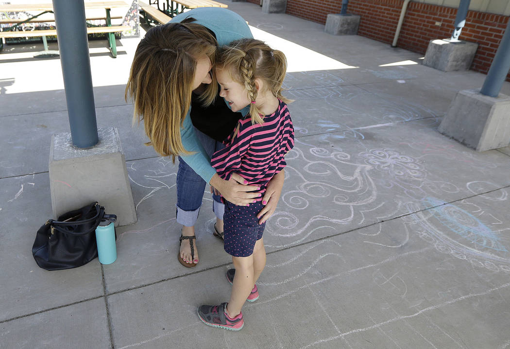 """Molly Maxwell hugs her child Gracie at the Bay Area Rainbow Day Camp in El Cerrito, Calif., on Tuesday, July 11, 2017. The camp caters to transgender and """"gender fluid"""" children, aged 4-12, making ..."""
