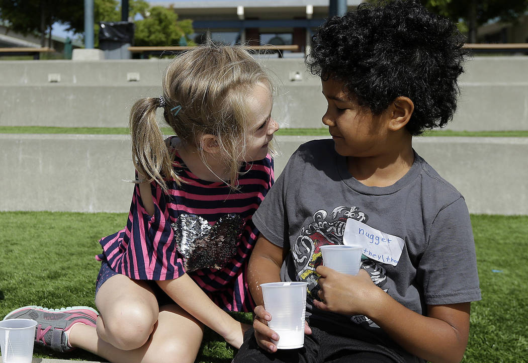 """Campers Gracie, left, leans toward Nugget during an activity at the Bay Area Rainbow Day Camp in El Cerrito, Calif., on Tuesday, July 11, 2017. The camp caters to transgender and """"gender fluid"""" ch ..."""
