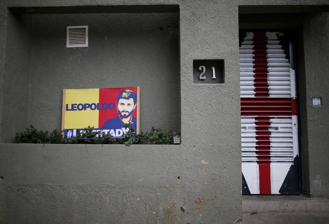 In this Tuesday, Aug. 1, 2017 photo, a sign with an image of jailed opposition leader Leopoldo Lopez sits outside his home in Caracas, Venezuela. Late Saturday, Lopez was returned home after being ...