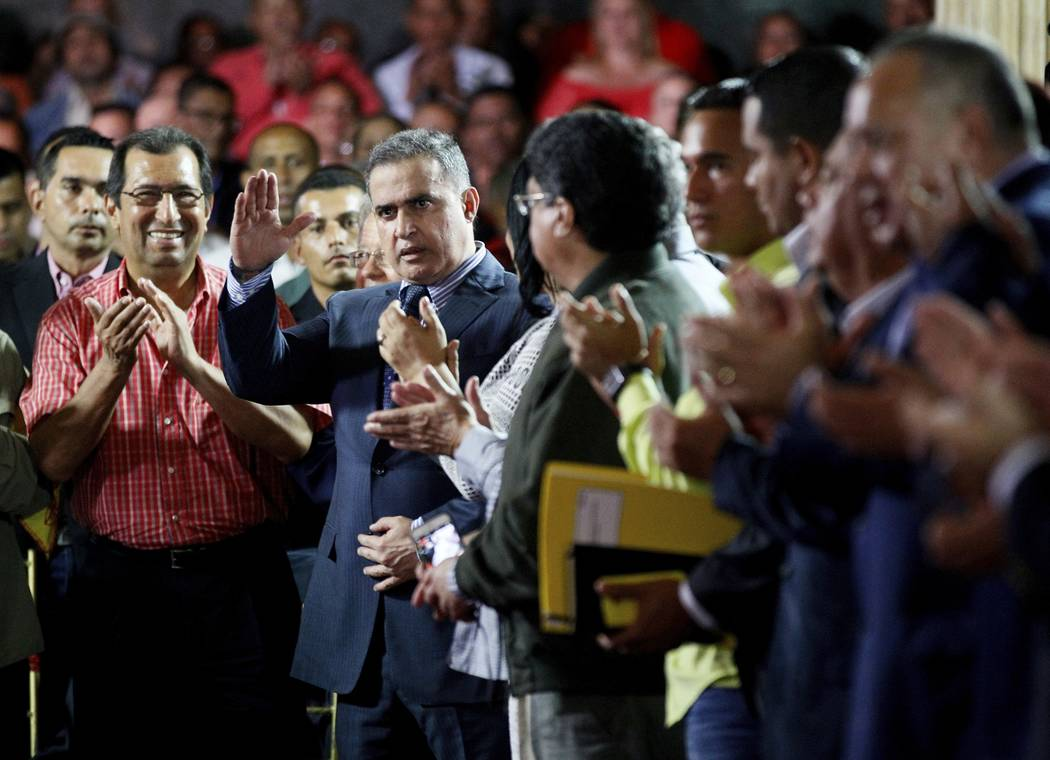 In this Saturday, Aug. 5, 2017 photo, Venezuela's ombudsman Tarek William Saab, center, is congratulated by members of Constitutional Assembly after he was sworn-in as the nation's new General Pro ...