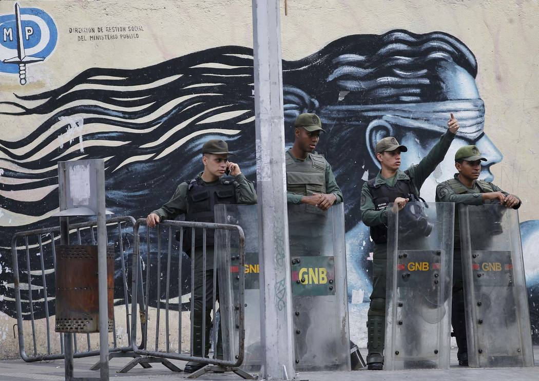 Venezuelan Bolivarian National Guards officers lineup outside of General Prosecutor headquarters in Caracas, Venezuela, Saturday, Aug. 5, 2017. Security forces surrounded the entrance to Venezuela ...