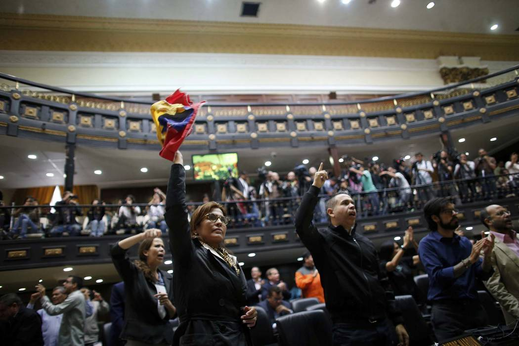 """In this Wednesday, Aug. 2, 2017 photo, anti-government lawmakers shout """"fraud"""" during a session at the National Assembly in Caracas, Venezuela. The National assembly's claim of a ..."""