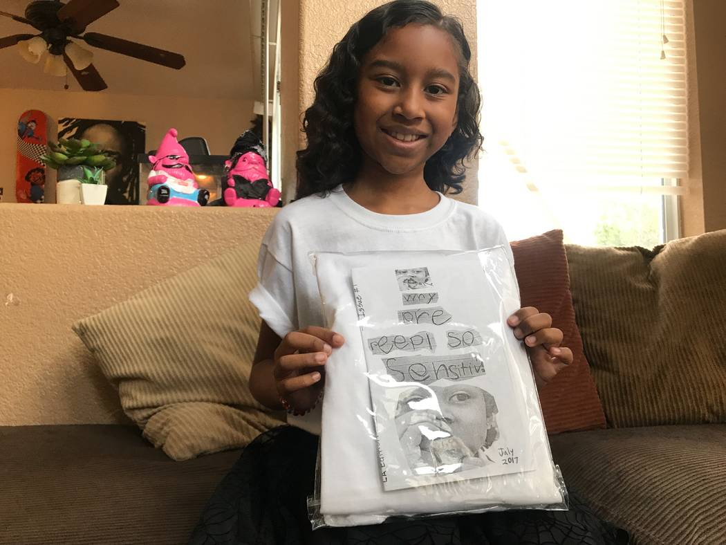 Kumei Norwood, 9, holding one of her zines on Aug. 6, 2017 in her North Las Vegas home. (Kailyn Brown/ View) @KailynHype