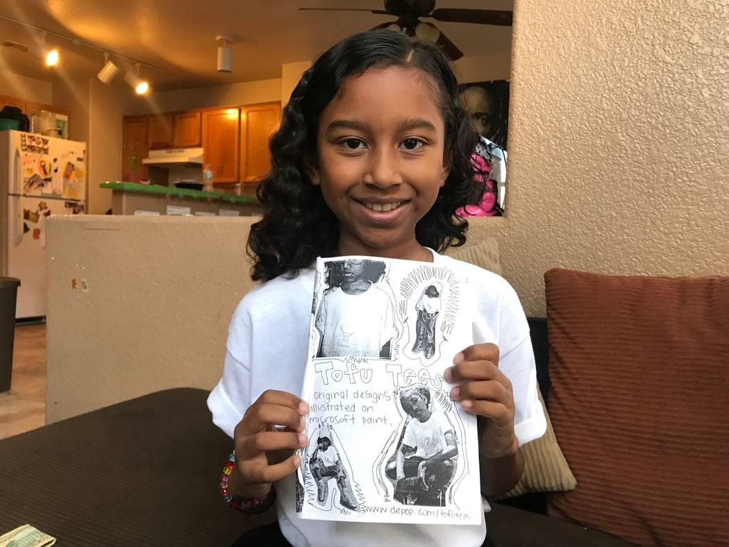 Kumei Norwood, 9, holding up one of her zines on Aug. 6, 2017 in her North Las Vegas home. (Kailyn Brown/ View) @KailynHype