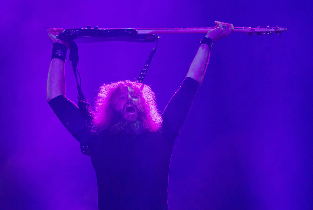 The bass player Troy Sanders of the heavy metal group Mastodon performs at the Rock in Rio music festival in Rio de Janeiro, Brazil, Friday, Sept. 25, 2015. (AP Photo/Leo Correa)