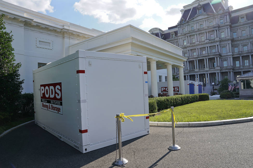 Moving and Storage containers are places on the driveway entrance to the West Wing of the White House in Washington, Saturday, Aug. 5, 2017. President Donald Trump and his staff temporarily moved  ...