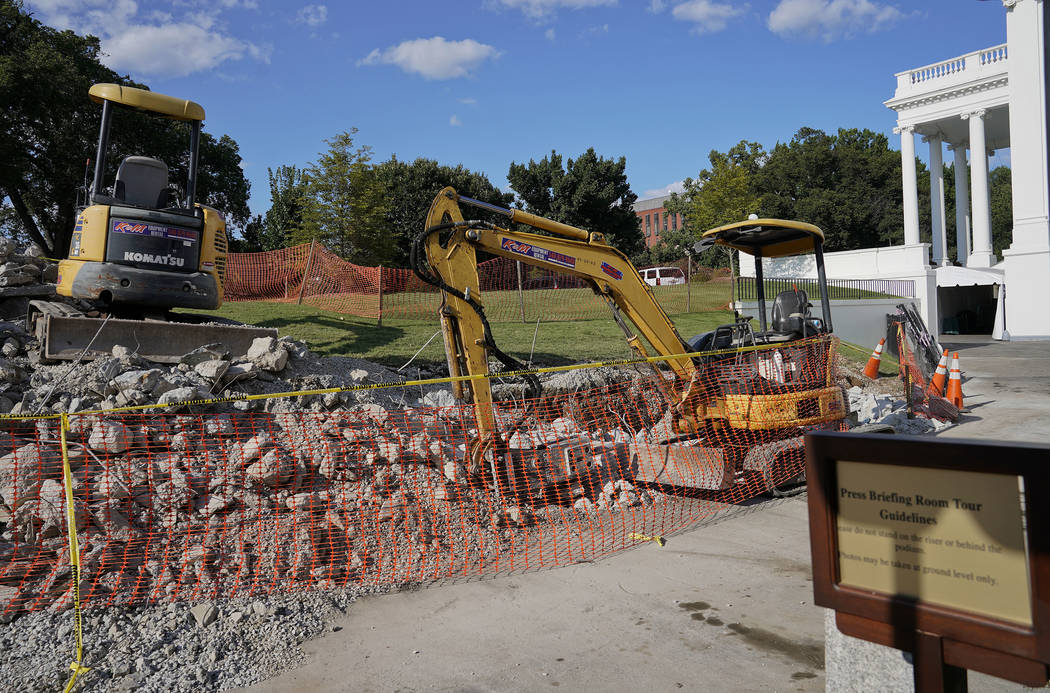 Construction machinery are seen on the ground White House grounds in Washington, Saturday, Aug. 5, 2017. President Donald Trump and his staff temporarily moved out of the West Wing as renovations  ...