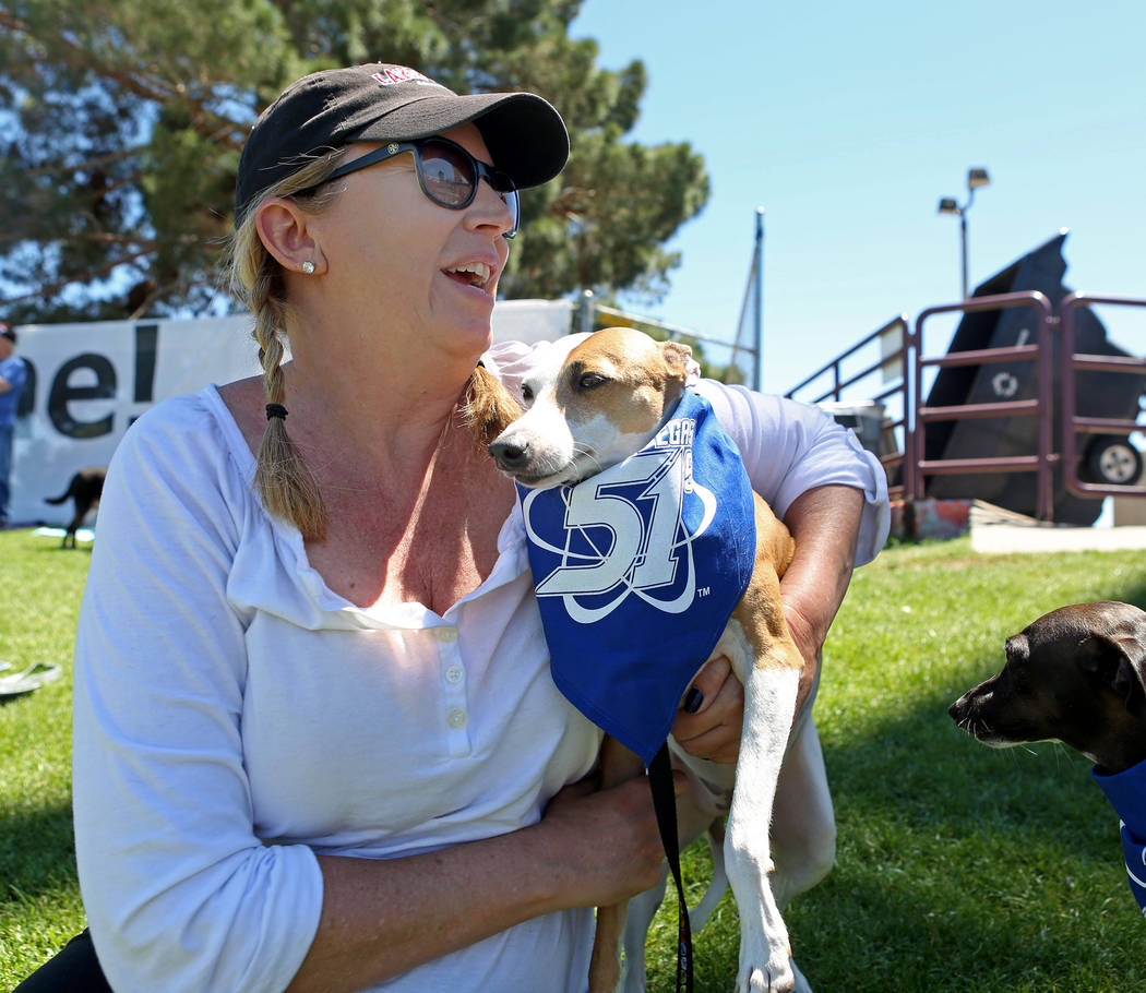 Sherrill Willmes holds one of her Italian Greyhounds during Bark in the Park, a tradition to bring your dogs to the game,  at Cashman Field in Las Vegas, Sunday, April 30, 2017. Elizabeth Brumley  ...
