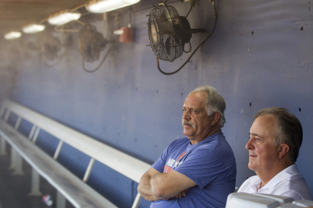 Las Vegas 51s manager Wally Backman, left, and president Don Logan sit at the team dugout before the start of the last home game of the season on Saturday, Aug. 27, 2016, in Las Vegas. (Erik Verdu ...