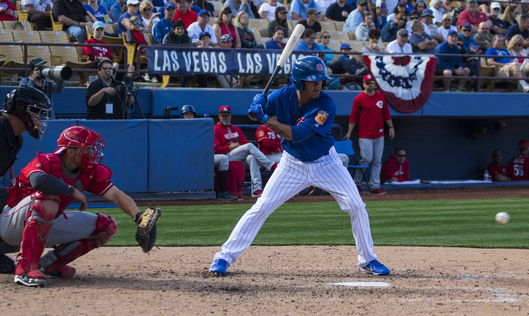 Chicago Cubs infielder Carlos Penalver (3) hits the ball during their Big League Weekend baseball game against the Cincinnati Reds at Cashman Field in Las Vegas on Saturday, March 25, 2017. (Miran ...