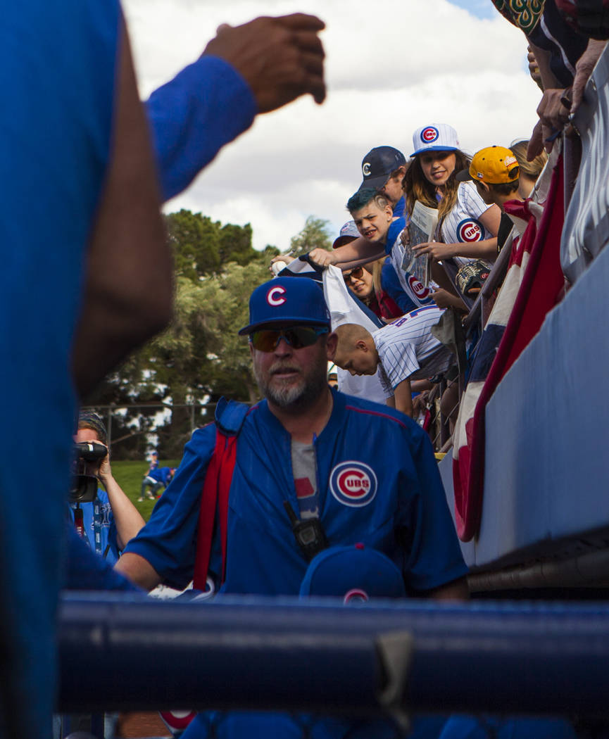 Fans watch the Chicago Cubs descend into the dugout after winning their Big League Weekend baseball game against the Chicago Cubs at Cashman Field in Las Vegas on Saturday, March 25, 2017. (Mirand ...