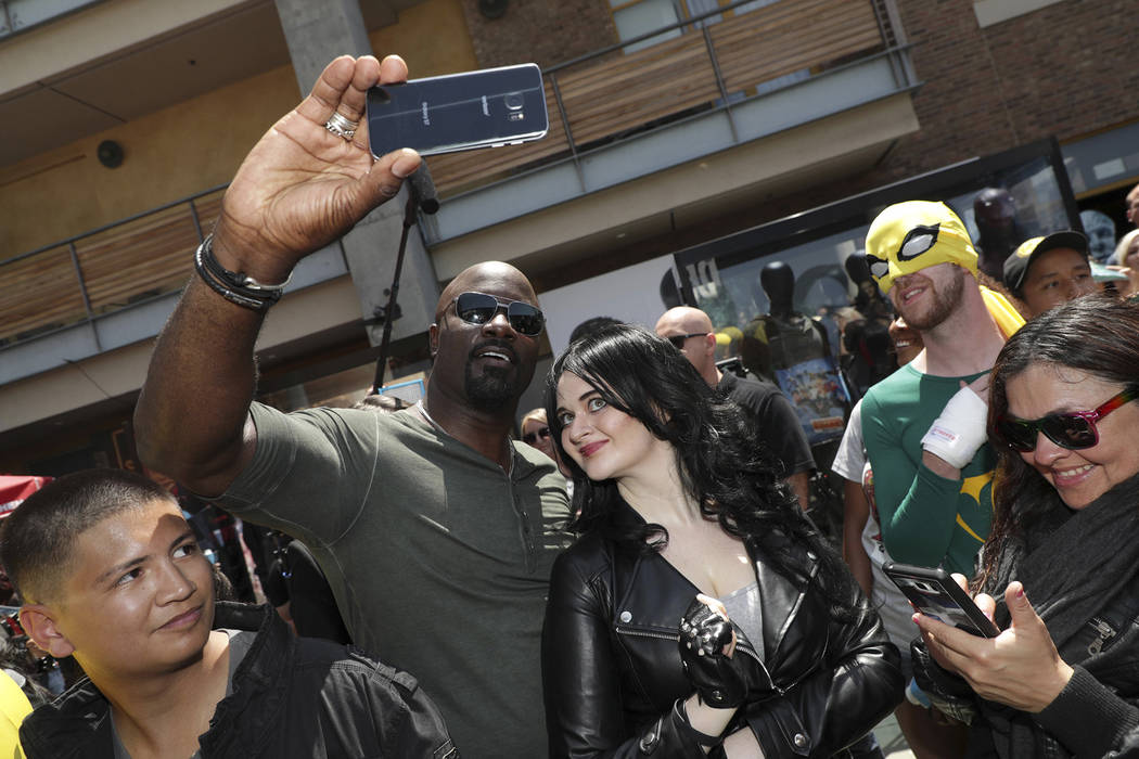Mike Colter takes a selfie with a fan at the Netflix Experience at Comic-Con in San Diego. (Eric Charbonneau)